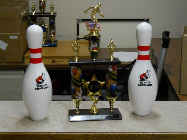 Bowling trophy next to pins on counter