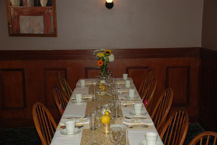Dining area with dining ware and a flower vase