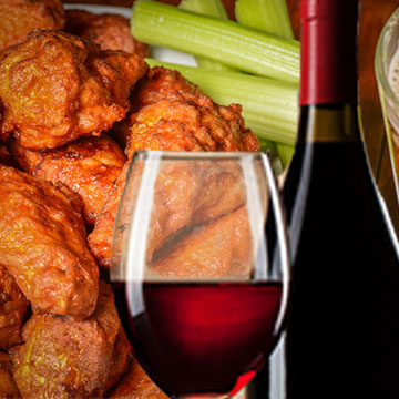 red wine in a glass and wings