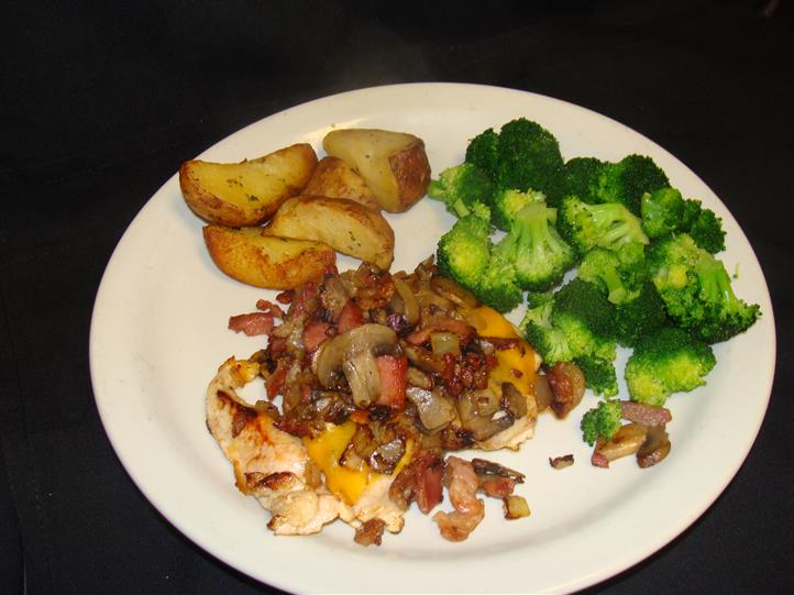 Side of potatoes and brocolli with mushrooms and bacon