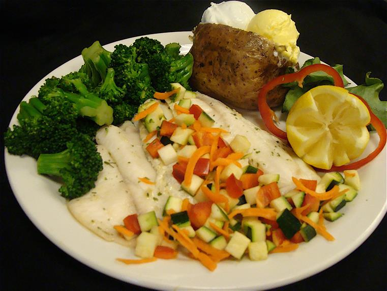 entree with a baked potato and broccoli