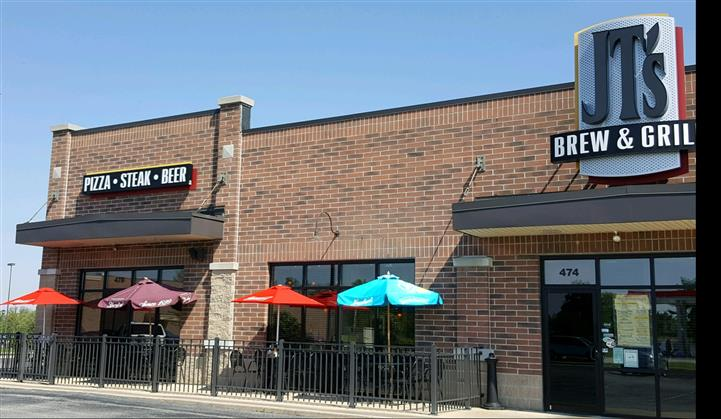 Exterior of restaurant with brick