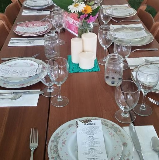large table with table settings and glassware
