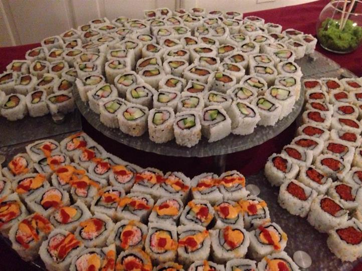 various catering displays of sushi