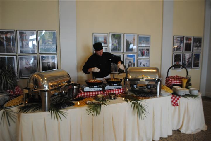 buffet setup with chef preparing food