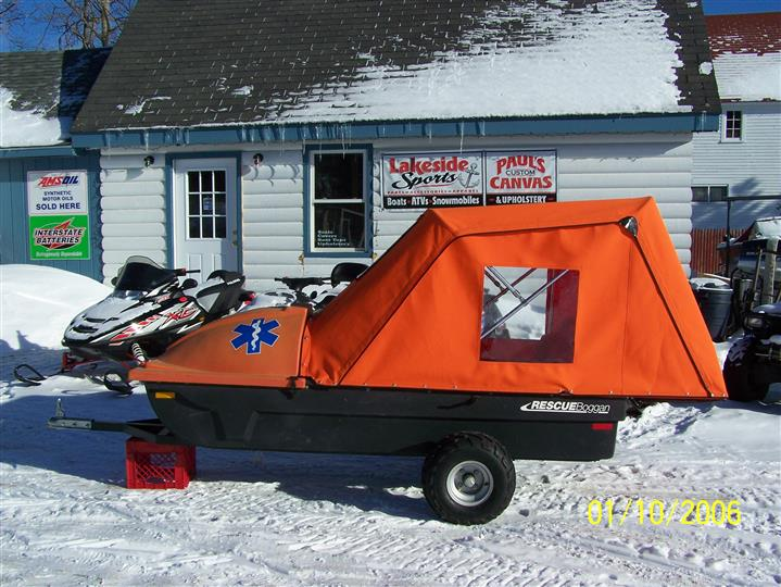 boat on a trailer with a tarp