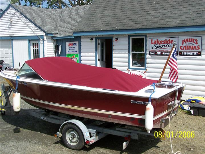 boat on a trailer parked next to the marina