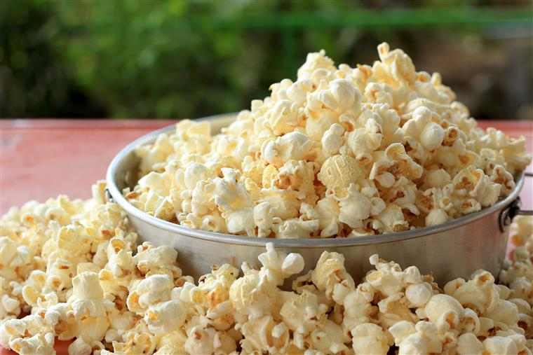 bowl overflowing with popcorn