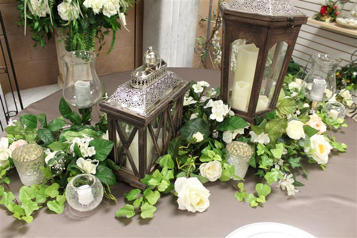white and green floral vines on a brown table