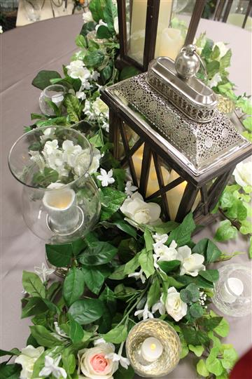 glass tables with green and white floral vines