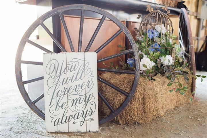 "a wagon wheel and a sign that says ""You will forever be my always"""