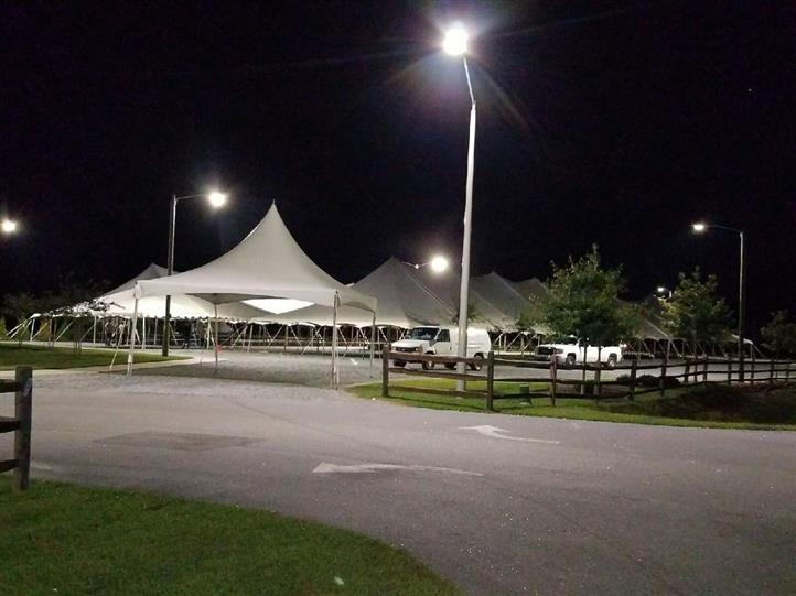 view of many big white tents outside