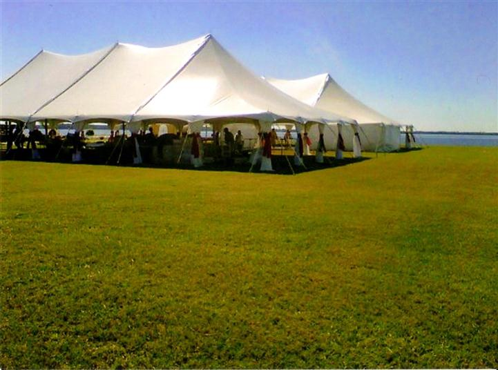big white tent on a green field