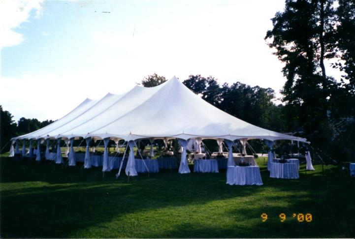 big white tent with autumn themed decorations