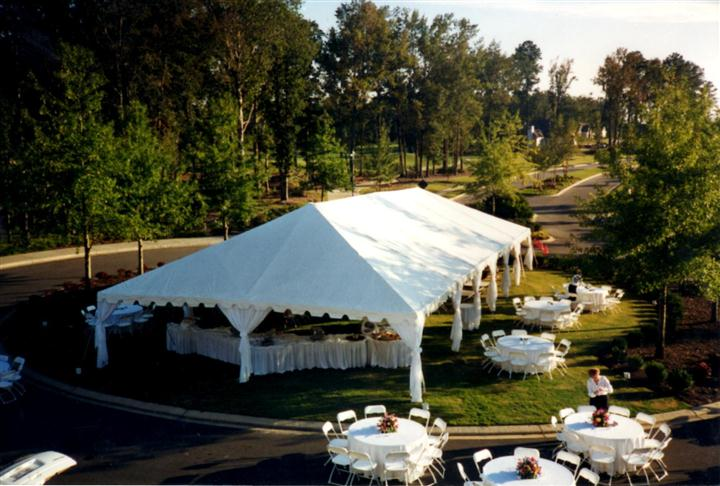 big white tent outdoors with tables and chairs