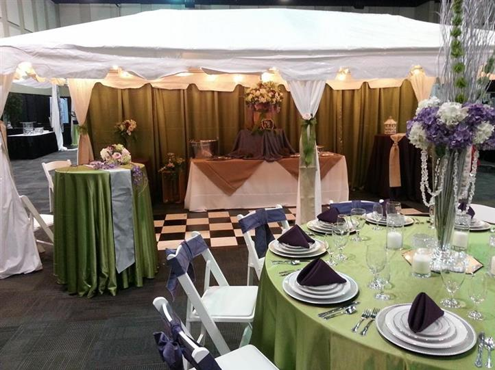 Our display booth at the 2014 bridal expo.  10x20 tent black & white dance floor tables