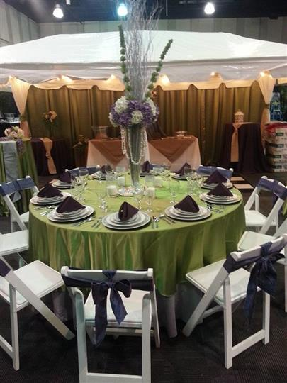 our booth at the 2014 bridal expo. 10x20 tent, dance floor, linens, centerpieces. decor, etc