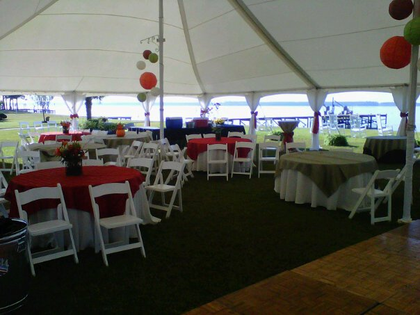 white tent with many chairs and tables under it