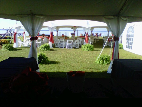 big white tent outdoors with circular table and balloons