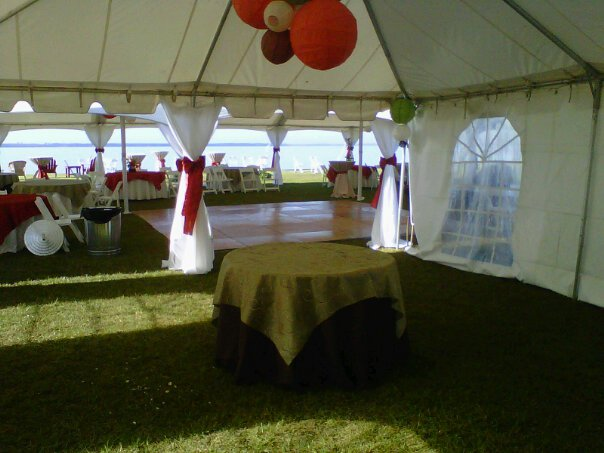 big white tent with tables and dance floor under it
