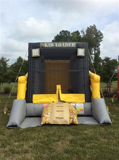 "a black, gray and yellow inflatable bouncer called ""skid loader"""