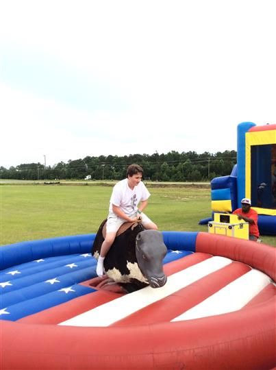 a kid riding a mechanical bull