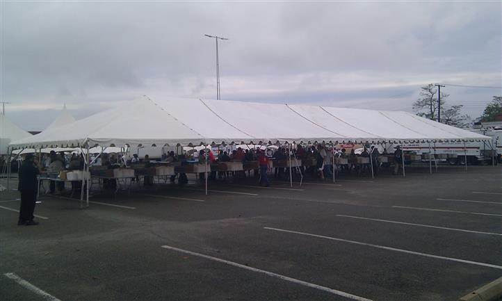 a large tent with many vendors under it