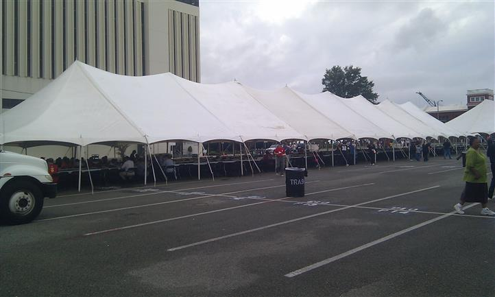 a large tent in a parking lot