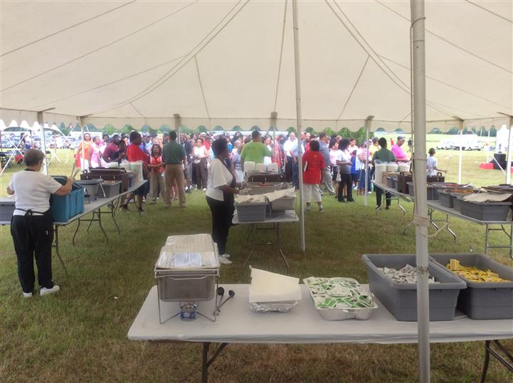 a large tent with tables of food under it