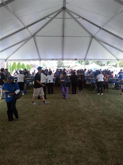 a large tent filled with many people under it