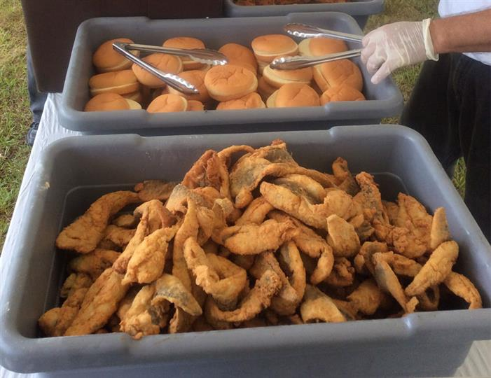 fried food and a tray of buns