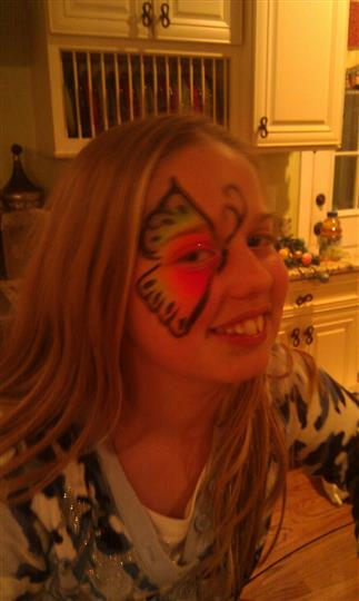 a girl with butterfly face painting