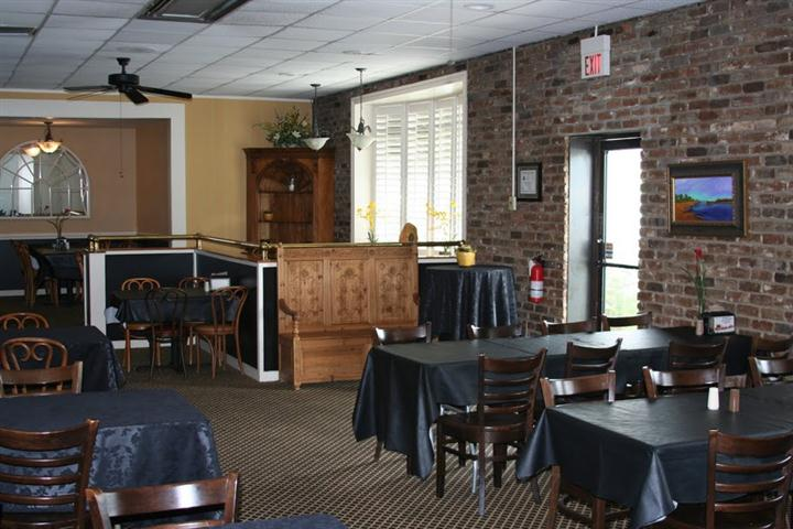 many tables and chairs inside restaurant