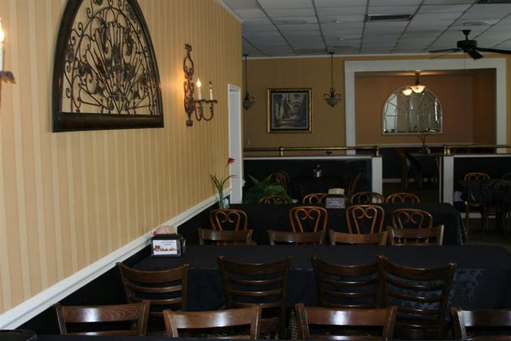 indoor seating area with long tables and many chairs per table