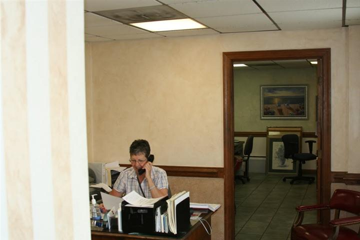 the receptionist taking calls