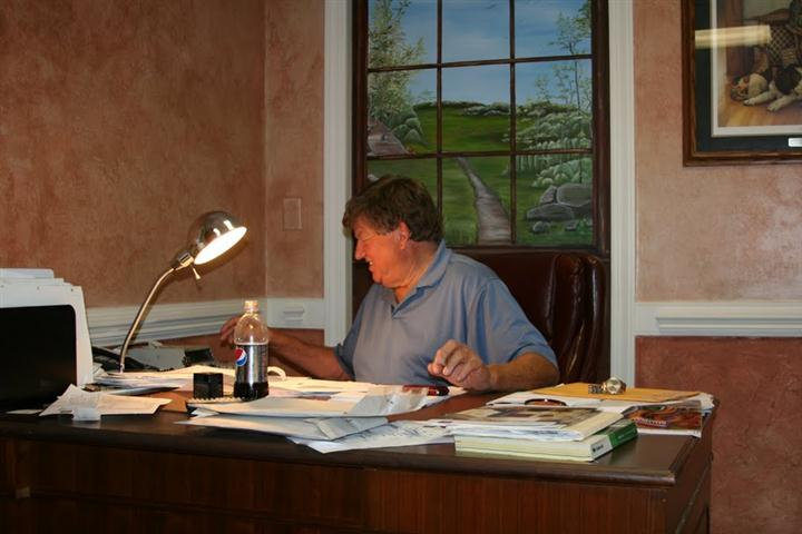 man working in the office of Abrams