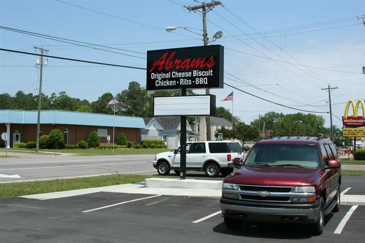 "the Abrams sign that says ""Abrams: original cheese biscuit- chicken - ribs - BBQ"""