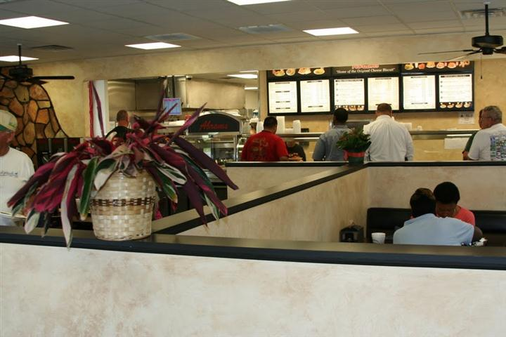 veiw of customers sitting at the restaurant with customers placing orders at the front register