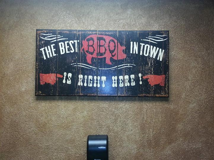 "a sign that says ""The Best BBQ in Town is Right Here!"""