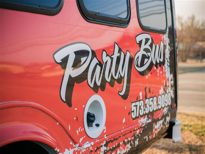 View of rear exterior of party bus. 573-358-9098