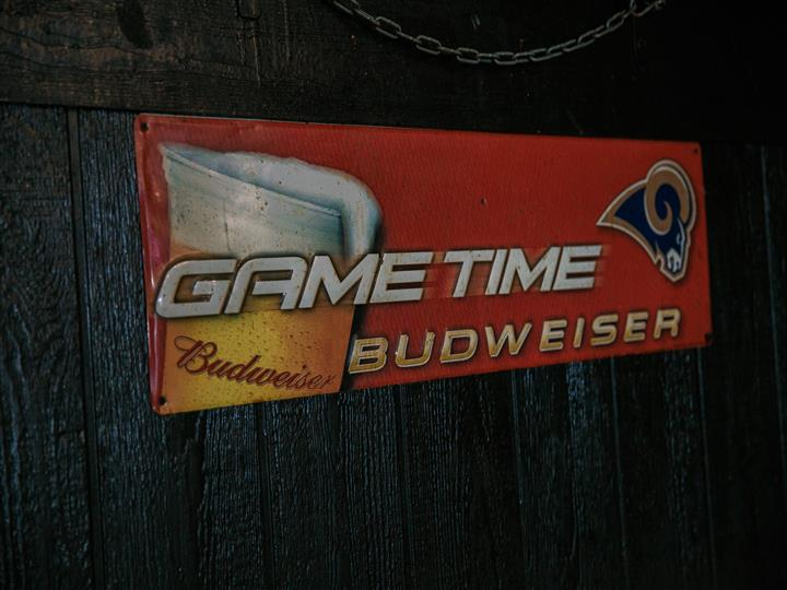 "Budweiser sign that reads ""Game time Budweiser"""