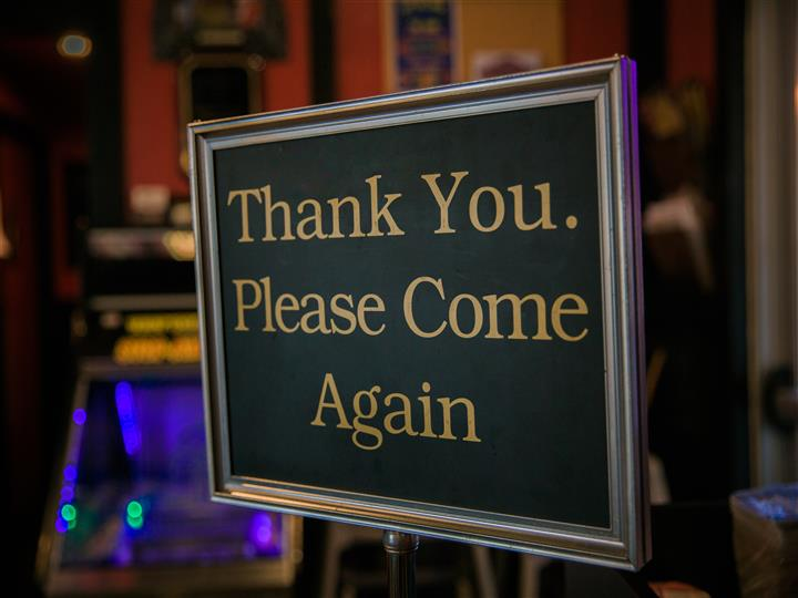 "Sign that reads ""Thank you come again."""