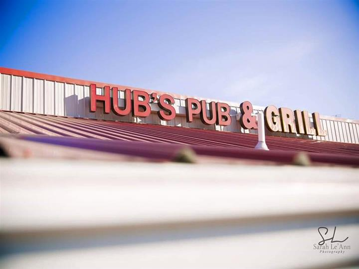 Hub's Pub & Grill sign at entrance