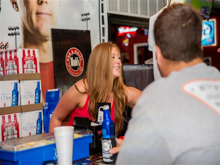 A bartender serving beverages to customers