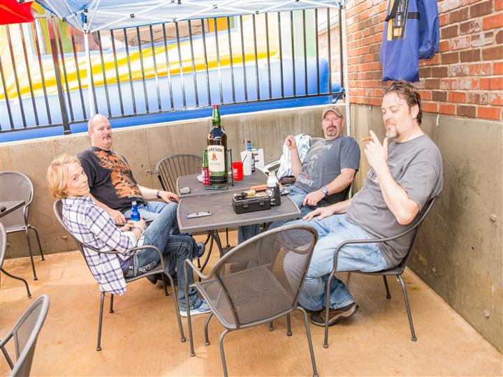 group of people sitting at an outdoor patio socializing