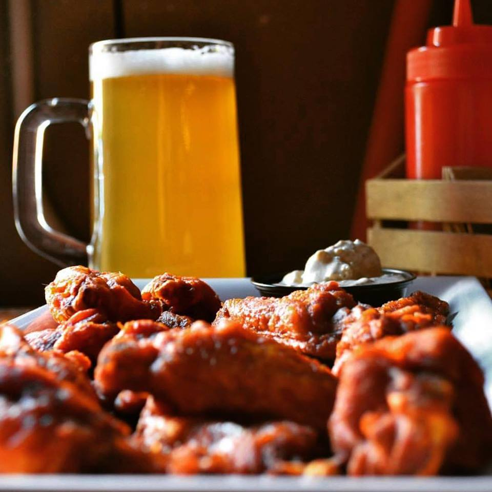 Chicken wings with a light beer in the background