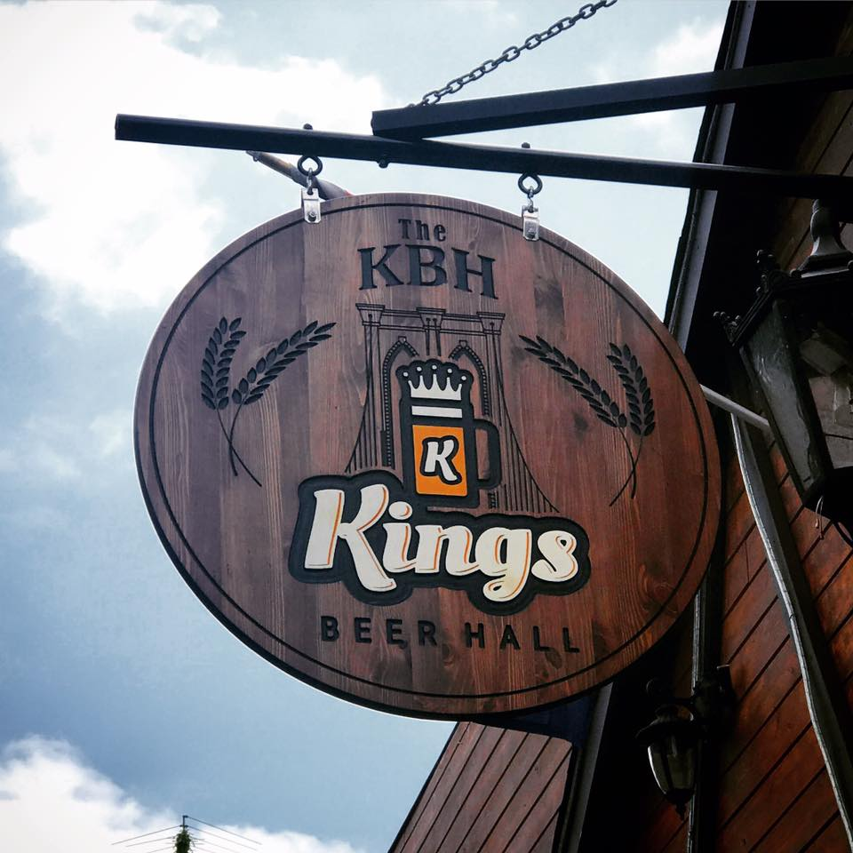 King Beer Hall wooden sign hanging outside the building
