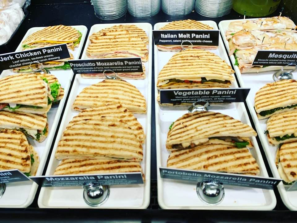 several trays of paninis