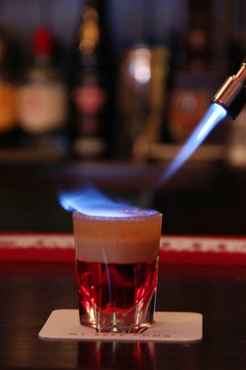 A red drink whit flames of fire