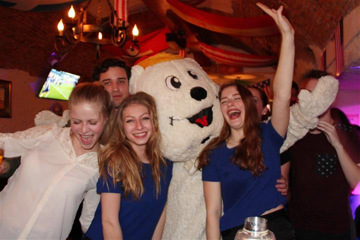 Five peple and a man in a white bear suit posing for a photo